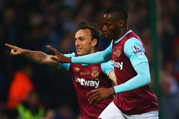 LONDON, ENGLAND - MAY 10:  Diafra Sakho of West Ham United (R) celebrates with team mate Mark Noble as he scores their first goalduring the Barclays Premier League match between West Ham United and Manchester United at the Boleyn Ground on May 10, 2016 in London, England. West Ham United are playing their last ever home match at the Boleyn Ground after their 112 year stay at the stadium. The Hammers will move to the Olympic Stadium for the 2016-17 season.  (Photo by Paul Gilham/Getty Images)
