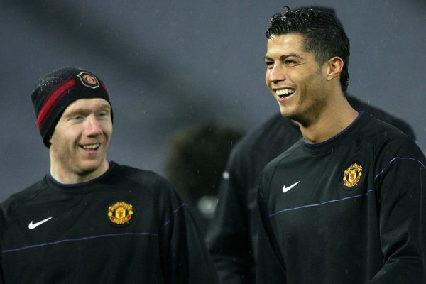 YOKOHAMA, JAPAN - DECEMBER 17:  Paul Scholes (L) and Cristiano Ronaldo of Manchester United relax during an official training session at the International Stadium Yokohama on December 17, 2008 in Yokohama, Kanagawa, Japan. Manchester United will play against Gamba Osaka in the FIFA Club World Cup Japan 2008 semi-final match on December 18.  (Photo by Kiyoshi Ota/Getty Images)