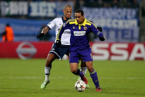 MARIBOR, SLOVENIA - DECEMBER 10:  Dennis Aogo (L) of Schalke battles for the ball with Tavares of Maribor during the UEFA Group G Champions League match between NK Maribor and FC Schalke 04 at Ljudski vrt Stadium on December 10, 2014 in Maribor, Slovenia.  (Photo by Alexander Hassenstein/Bongarts/Getty Images)