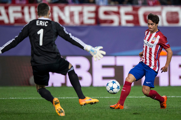 MADRID, SPAIN - OCTOBER 21:  Oliver Torres (R) of Atletico de Madrid scores their third goal during the UEFA Champions League Group C match between Club Atletico de Madrid and FC Astana at Vicente Calderon stadium on October 21, 2015 in Madrid, Spain.  (Photo by Gonzalo Arroyo Moreno/Getty Images)