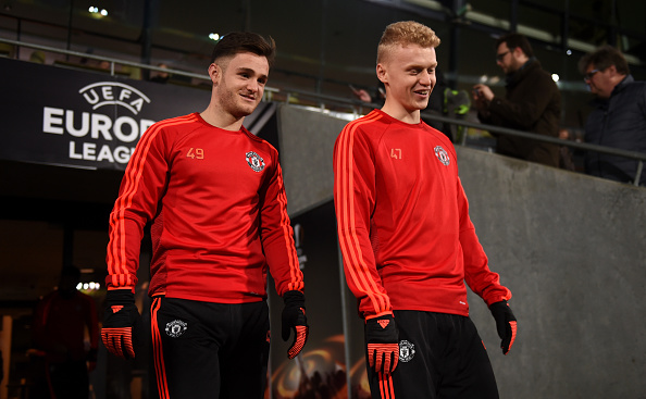 HERNING, DENMARK - FEBRUARY 17:  Joe Riley and James Weir of Manchester United make their way out onto the pitch during a training session ahead of the UEFA Europa League Round of 32 match between FC Midtjylland and Manchester United at Herning MCH Multi Arena on February 17, 2016 in Herning, Denmark.  (Photo by Michael Regan/Getty Images)