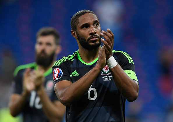 LYON, FRANCE - JULY 06:  Ashley Williams of Wales applauds the supporters after the UEFA EURO 2016 semi final match between Portugal and Wales at Stade des Lumieres on July 6, 2016 in Lyon, France.  (Photo by Stu Forster/Getty Images)