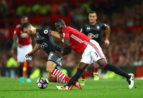 MANCHESTER, ENGLAND - AUGUST 19: Eric Bailly of Manchester United tackles Shane Long of Southampton during the Premier League match between Manchester United and Southampton at Old Trafford on August 19, 2016 in Manchester, England.  (Photo by Michael Steele/Getty Images)