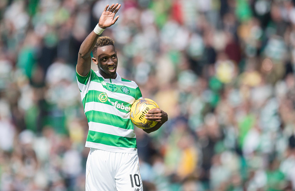 GLASGOW , SCOTLAND - SEPTEMBER 10: Moussa Dembele of Celtic takes away the match ball having scored 3 of the 5 goals during the Ladbrokes Scottish Premiership match between Celtic and Rangers at Celtic Park on September 10, 2016 in Glasgow. (Photo by Steve  Welsh/Getty Images)