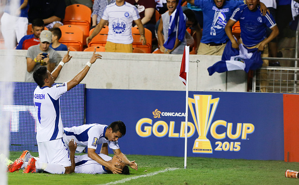 HOUSTON, TX - JULY 11:  Dustin Corea, of El Salvador bottom, is mobbed by his teammates after scoring in the second half against Costa Rica at BBVA Compass Stadium on July 11, 2015 in Houston, Texas.  (Photo by Bob Levey/Getty Images)