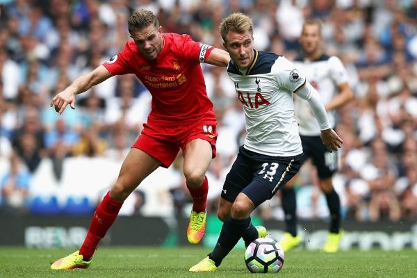 LONDON, ENGLAND - AUGUST 27:  Jordan Henderson of Liverpool (L) and Christian Eriksen of Tottenham Hotspur (R) battle for possession during the Premier League match between Tottenham Hotspur and Liverpool at White Hart Lane on August 27, 2016 in London, England.  (Photo by Jan Kruger/Getty Images)