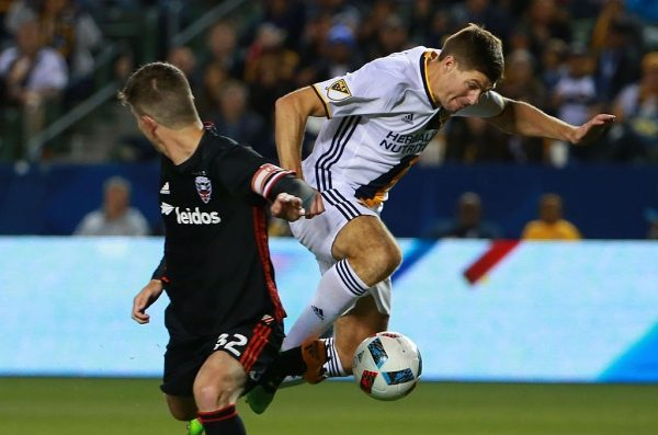 CARSON, CA - MARCH 06:  Steven Gerrard #8 of Los Angeles Galaxy and Bobby Boswell #32 of D.C. United vie for the ball during the second half of their MLS match at StubHub Center on March 6, 2016 in Carson, California. The Galaxy defeated United 4-1.  (Photo by Victor Decolongon/Getty Images)