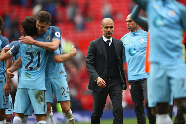 MANCHESTER, ENGLAND - SEPTEMBER 10: Manchester City manager Pep Guardiola with his team after the final whistle of the Premier League match between Manchester United and Manchester City at Old Trafford on September 10, 2016 in Manchester, England.  (Photo by Clive Brunskill/Getty Images)