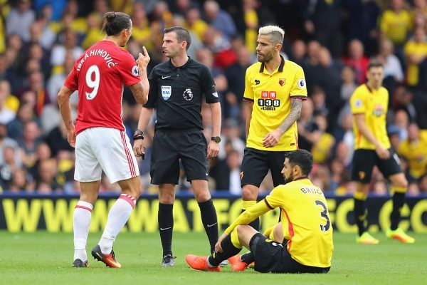 WATFORD, ENGLAND - SEPTEMBER 18: Zlatan Ibrahimovic of Manchester United aruges with referee Michael Oliver after fouling Miguel Britos of Watford  during the Premier League match between Watford and Manchester United at Vicarage Road on September 18, 2016 in Watford, England.  (Photo by Richard Heathcote/Getty Images)
