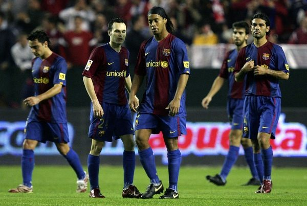 SEVILLE, SPAIN - MARCH 03: Ronaldinho (R) and Andres Iniesta of Barcelona react after Sevilla scored their 2nd goal during the Primera Liga match between Sevilla and Barcelona at the Sanchez Pizjuan stadium on March 3, 2007 in Seville, Spain.  (Photo by Denis Doyle/Getty Images) *** Local Caption *** Ronaldinho;Andres Iniesta