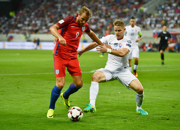 TRNAVA, SLOVAKIA - SEPTEMBER 04:  Harry Kane of England holds off Tomas Hubocan of Slovakia during the 2018 FIFA World Cup Group F qualifying match between Slovakia and England at City Arena on September 4, 2016 in Trnava, Slovakia.  (Photo by Dan Mullan/Getty Images)