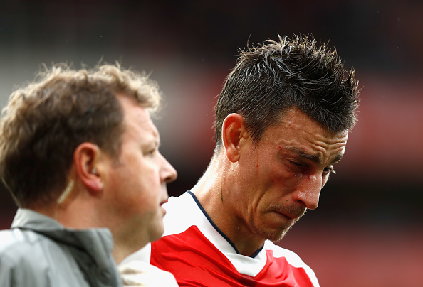 LONDON, ENGLAND - SEPTEMBER 10:  Laurent Koscielny of Arsenal reacts after getting a injury during the Premier League match between Arsenal and Southampton at Emirates Stadium on September 10, 2016 in London, England.  (Photo by Clive Rose/Getty Images)