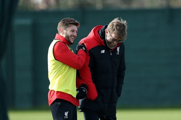 LIVERPOOL, ENGLAND - FEBRUARY 26:  Liverpool manager Jurgen Klopp shares a joke with Adam Lallana during a training session ahead of their Capital One Cup final match against Manchester City at Melwood Training Ground on February 26, 2016 in Liverpool, United Kingdom.  (Photo by Jan Kruger/Getty Images)