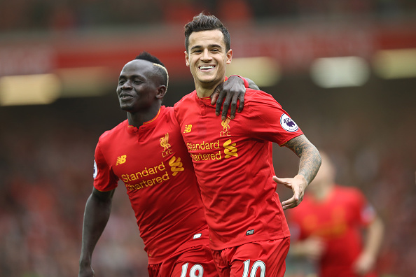 LIVERPOOL, ENGLAND - SEPTEMBER 24:  Philippe Coutinho of Liverpool celebrates with Sadio Mane as he scores their fourth goal during the Premier League match between Liverpool and Hull City at Anfield on September 24, 2016 in Liverpool, England.  (Photo by Julian Finney/Getty Images)