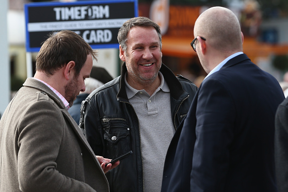 CHELTENHAM, ENGLAND - MARCH 11: Ex footballer Paul Merson enjoying  day two of the Cheltenham Festival at Cheltenham Racecourse on March 11, 2015 in Cheltenham, England.  (Photo by Michael Steele/Getty Images)