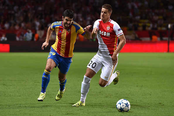 MONACO - AUGUST 25:  Mario Pasalic (R) of Monaco competes with Antonio Barragan of Valencia during the UEFA Champions League qualifying round play off second leg match between Monaco and Valencia on August 25, 2015 in Monaco, Monaco.  (Photo by Valerio Pennicino/Getty Images)