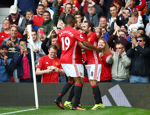 MANCHESTER, ENGLAND - SEPTEMBER 24: Juan Mata of Manchester United (R) celebrates scoring his sides second goal with Marcus Rashford of Manchester United (L) during the Premier League match between Manchester United and Leicester City at Old Trafford on September 24, 2016 in Manchester, England.  (Photo by Clive Brunskill/Getty Images)