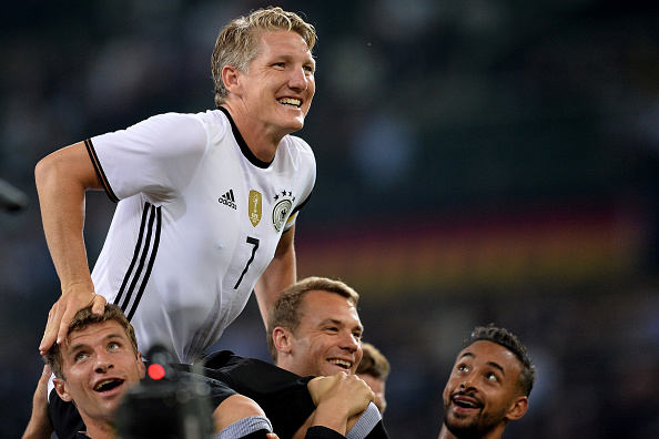 MOENCHENGLADBACH, GERMANY - AUGUST 31:  Players of Germany celebrate Bastian Schweinsteiger after the international friendly match between Germany and Finland at Borussia-Park on August 31, 2016 in Moenchengladbach, Germany.  (Photo by Sascha Steinbach/Bongarts/Getty Images)