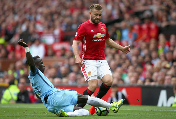 MANCHESTER, ENGLAND - SEPTEMBER 10: Luke Shaw of Manchester United is tackled Bacary Sagna of Manchester City during the Premier League match between Manchester United and Manchester City at Old Trafford on September 10, 2016 in Manchester, England.  (Photo by Alex Livesey/Getty Images)