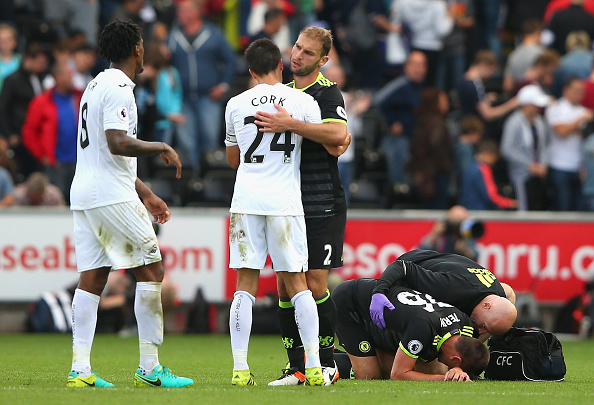 SWANSEA, WALES - SEPTEMBER 11:  Jack Cork of Swansea City and Branislav Ivanovic of Chelsea embrace as John Terry of Chelsea is given treatment after the Premier League match between Swansea City and Chelsea at Liberty Stadium on September 11, 2016 in Swansea, Wales.  (Photo by Alex Livesey/Getty Images)