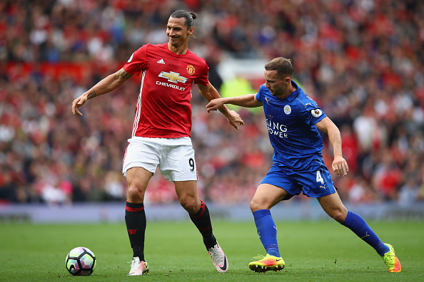 MANCHESTER, ENGLAND - SEPTEMBER 24:  Zlatan Ibrahimovic of Manchester United holds off a challenge from Danny Drinkwater of Leicester City during the Premier League match between Manchester United and Leicester City at Old Trafford on September 24, 2016 in Manchester, England.  (Photo by Clive Brunskill/Getty Images)