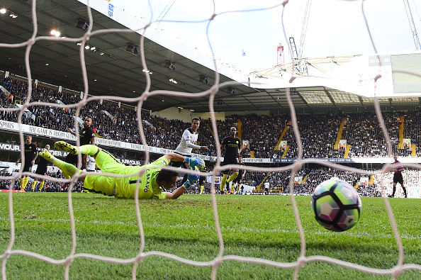 LONDON, ENGLAND - OCTOBER 02:  Dele Alli of Tottenham Hotspur scores his sides second goal during the Premier League match between Tottenham Hotspur and Manchester City at White Hart Lane on October 2, 2016 in London, England.  (Photo by Shaun Botterill/Getty Images)