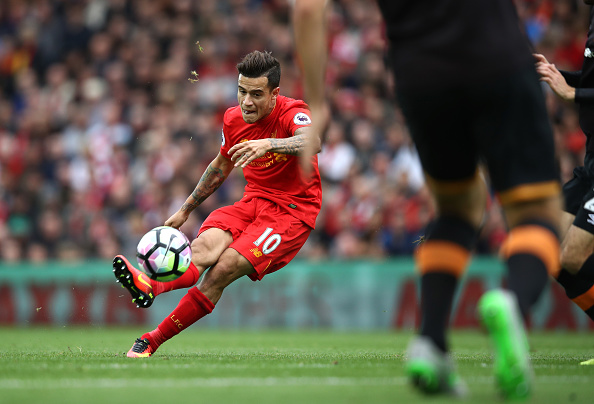 LIVERPOOL, ENGLAND - SEPTEMBER 24:  Philippe Coutinho of Liverpool scores their fourth goal during the Premier League match between Liverpool and Hull City at Anfield on September 24, 2016 in Liverpool, England.  (Photo by Julian Finney/Getty Images)