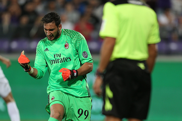 FLORENCE, ITALY - SEPTEMBER 25: Gianluigi Donnarumma goalkeeper of AC Milan celebrates after he saved a penalty kick from Josip Ilicic during the Serie A match between ACF Fiorentina and AC Milan at Stadio Artemio Franchi on September 25, 2016 in Florence, Italy.  (Photo by Gabriele Maltinti/Getty Images)