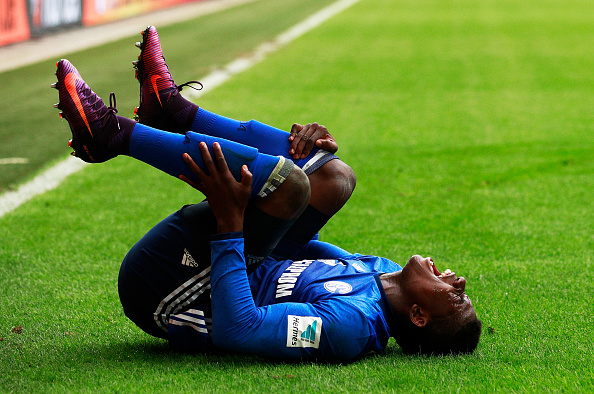 AUGSBURG, GERMANY - OCTOBER 15:  Breel Donald Embolo of Schalke 04 is injured by Kostas Stafylidis of Augsburg during the Bundesliga match between FC Augsburg and FC Schalke 04 at WWK Arena on October 15, 2016 in Augsburg, Germany.  (Photo by Adam Pretty/Bongarts/Getty Images)