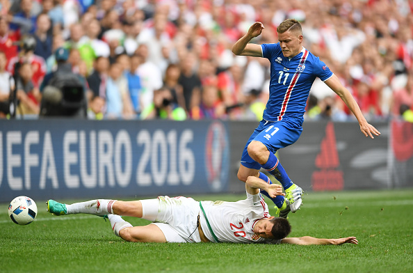 MARSEILLE, FRANCE - JUNE 18: Richard Guzmics of Hungary tackles Alfred Finnbogason of Iceland during the UEFA EURO 2016 Group F match between Iceland and Hungary at Stade Velodrome on June 18, 2016 in Marseille, France.  (Photo by Laurence Griffiths/Getty Images)
