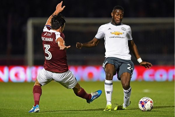 NORTHAMPTON, ENGLAND - SEPTEMBER 21:  Timothy Fosu-Mensah of Manchester United and David Buchanan of Northampton Town in action during the  EFL Cup Third Round match between Northampton Town and Manchester United at Sixfields on September 21, 2016 in Northampton, England.  (Photo by Shaun Botterill/Getty Images)