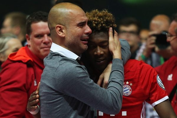 BERLIN, GERMANY - MAY 21:  Pep Guardiola of Bayern Muenchen cries while hugging his player David Alaba after winning the DFB Cup Final in a penalty shootout against Borussia Dortmund at Olympiastadion on May 21, 2016 in Berlin, Germany.  (Photo by Lars Baron/Bongarts/Getty Images)