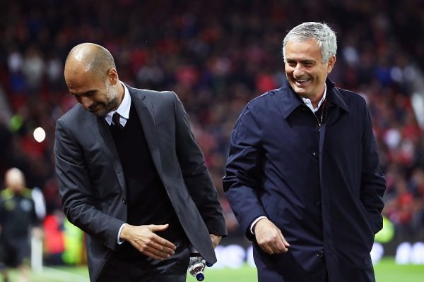 MANCHESTER, ENGLAND - OCTOBER 26: Josep Guardiola, Manager of Manchester City (L) and Jose Mourinho, Manager of Manchester United (R) share a joke prior to kick off during the EFL Cup fourth round match between Manchester United and Manchester City at Old Trafford on October 26, 2016 in Manchester, England.  (Photo by Michael Steele/Getty Images)
