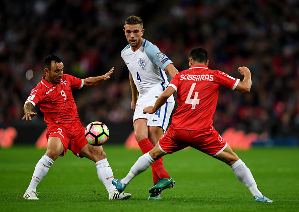 LONDON, ENGLAND - OCTOBER 08: Jordan Henderson of England passes under pressure from Michael Mifsud of Malta (L) and Gareth Sciberras of Malta (R) during the FIFA 2018 World Cup Qualifier Group F match between England and Malta at Wembley Stadium on October 8, 2016 in London, England.  (Photo by Laurence Griffiths/Getty Images)