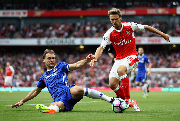 LONDON, ENGLAND - SEPTEMBER 24:  Branislav Ivanovic of Chelsea (L) tackles Nacho Monreal of Arsenal (R) during the Premier League match between Arsenal and Chelsea at the Emirates Stadium on September 24, 2016 in London, England.  (Photo by Paul Gilham/Getty Images)