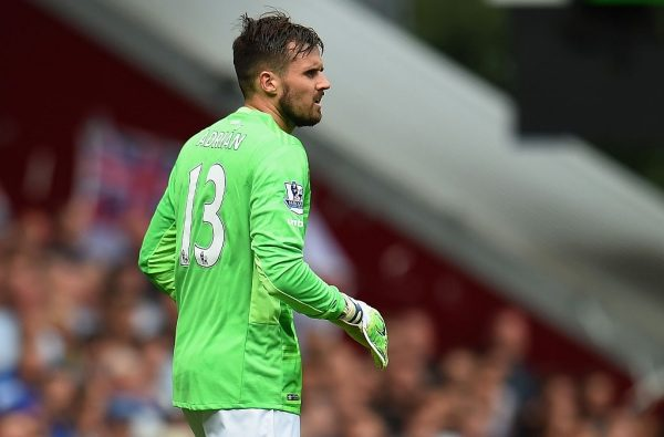 LONDON, ENGLAND - AUGUST 15:  Carl Jenkinson of West Ham United wearing a goalkeeper shirt looks on after Adrian of West Ham United was sent off during the Barclays Premier League match between West Ham United and Leicester City at the Boleyn Ground on August 15, 2015 in London, United Kingdom.  (Photo by Michael Regan/Getty Images)