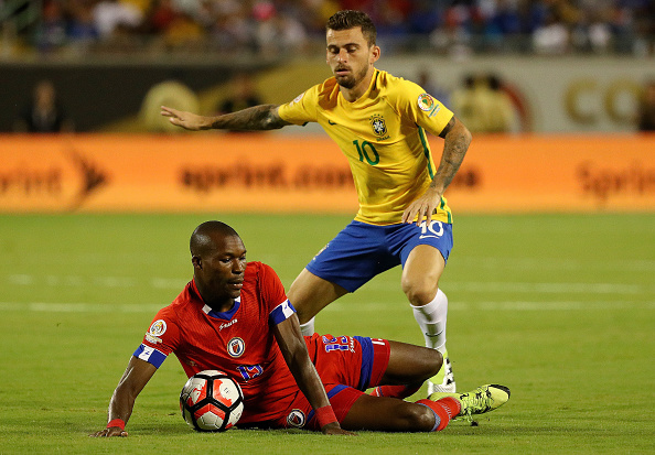 ORLANDO, FL - JUNE 08:  Lucas Lima #10 of Brazil and James Marcelin #15 of Haiti fight for the ball during a Group B match of the 2016 Copa America Centenario at Camping World Stadium on June 8, 2016 in Orlando, Florida.  (Photo by Mike Ehrmann/Getty Images)