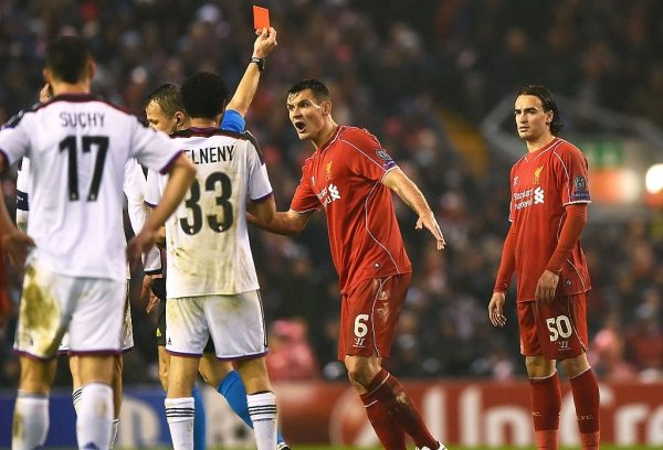 LIVERPOOL, ENGLAND - DECEMBER 09:  Dejan Lovren #6 of Liverpool reacts as teammate Lazar Markovic #50 of Liverpool is shown the red card card during the UEFA Champions League group B match between Liverpool and FC Basel 1893 at Anfield on December 9, 2014 in Liverpool, United Kingdom.  (Photo by Laurence Griffiths/Getty Images)