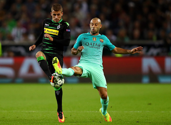 MOENCHENGLADBACH, GERMANY - SEPTEMBER 28:  Thorgan Hazard of Borussia Moenchengladbach battles for the ball with Javier Mascherano of Barcelona   during the UEFA Champions League group C match between VfL Borussia Moenchengladbach and FC Barcelona at Borussia-Park on September 28, 2016 in Moenchengladbach, North Rhine-Westphalia.  (Photo by Dean Mouhtaropoulos/Bongarts/Getty Images)
