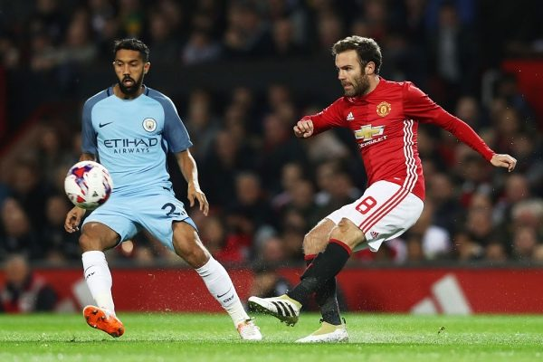 MANCHESTER, ENGLAND - OCTOBER 26: Juan Mata of Manchester United (R) shoots during the EFL Cup fourth round match between Manchester United and Manchester City at Old Trafford on October 26, 2016 in Manchester, England.  (Photo by David Rogers/Getty Images)