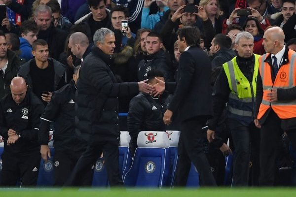 LONDON, ENGLAND - OCTOBER 23: Antonio Conte, Manager of Chelsea shakes hands with Jose Mourinho, Manager of Manchester United after the full time whistle during the Premier League match between Chelsea and Manchester United at Stamford Bridge on October 23, 2016 in London, England.  (Photo by Mike Hewitt/Getty Images)