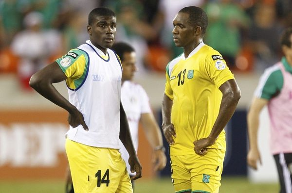 HOUSTON, TX - OCTOBER 12: A dejected Charles Pollard #13 and Colin Nelson #14 stand on the field at BBVA Compass Stadium on October 12, 2012 in Houston, Texas. Mexico defeated Guyana 5-0. (Photo by Bob Levey/Getty Images)
