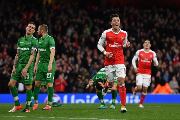LONDON, ENGLAND - OCTOBER 19:  Mesut Ozil of Arsenal celebrates after scoring his third and his team's sixth goal of the game during the UEFA Champions League group A match between Arsenal FC and PFC Ludogorets Razgrad at the Emirates Stadium on October 19, 2016 in London, England.  (Photo by Mike Hewitt/Getty Images)