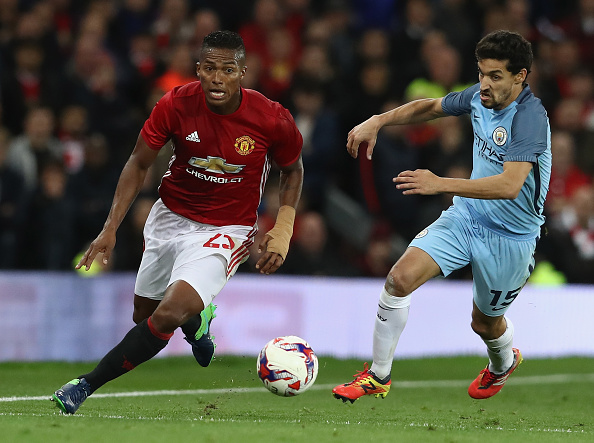 MANCHESTER, ENGLAND - OCTOBER 26:  Antonio Valencia (L) of Manchester United moves away from Jesus Navas during the EFL Cup Fourth Round match between Manchester United and Manchester City at Old Trafford on October 26, 2016 in Manchester, England.  (Photo by David Rogers/Getty Images)