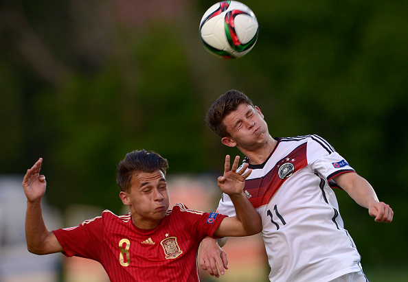 STARA ZAGORA, BULGARIA - MAY 15:   Mats Köhlert of Germany U17 heads the ball next to Fran Villalba of Spain U17 during the UEFA European Under-17 Championship quarter finals match between Germany U17 and Spain U17 at Beroe stadium on May 15, 2015 in Stara Zagora, Bulgaria. (Photo by Nikolay Doychinov/Getty Images)