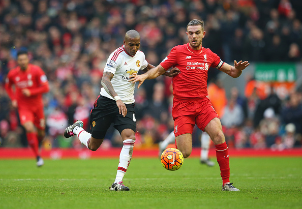 LIVERPOOL, ENGLAND - JANUARY 17: Ashley Young of Manchester United challenges for the ball with Jordan Henderson of Liverpool during the Barclays Premier League match between Liverpool and Manchester United at Anfield on January 17, 2016 in Liverpool, England.  (Photo by Alex Livesey/Getty Images)