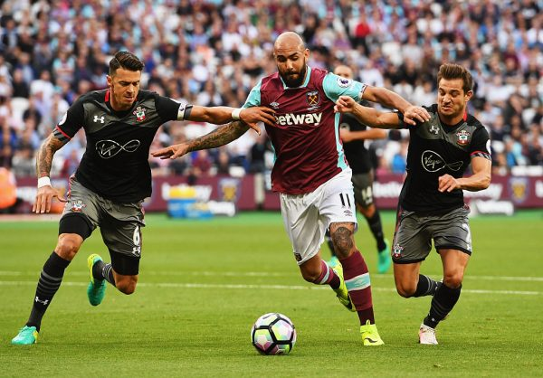 LONDON, ENGLAND - SEPTEMBER 25:  Simone Zaza of West Ham United tangles with Jose Fonte (L) and Cedric Soares of Southampton (R) during the Premier League match between West Ham United and Southampton at London Stadium on September 25, 2016 in London, England.  (Photo by Shaun Botterill/Getty Images)