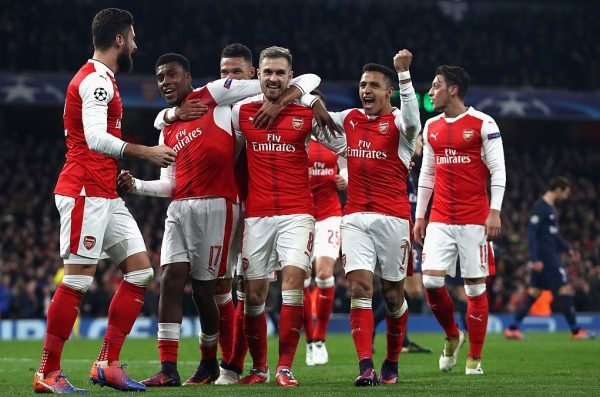 LONDON, ENGLAND - NOVEMBER 23: The Arsenal team celebrate after Marco Verratti of PSG (not pictured) scored a own goal for Arsenal's second goal during the UEFA Champions League Group A match between Arsenal FC and Paris Saint-Germain at the Emirates Stadium on November 23, 2016 in London, England.  (Photo by Julian Finney/Getty Images)