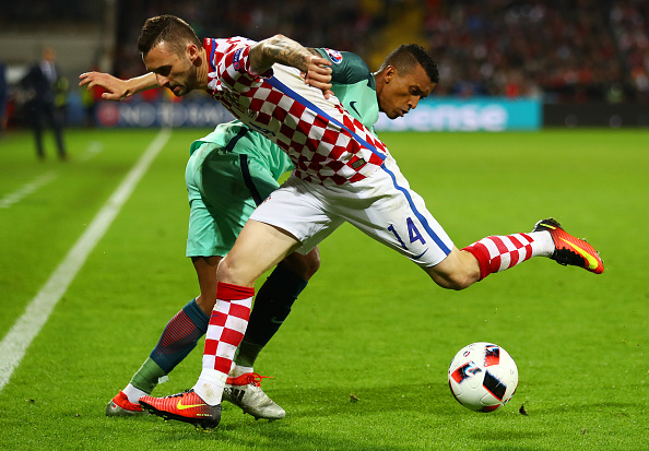 LENS, FRANCE - JUNE 25: Marcelo Brozovic of Croatia and Nani of Portugal compete for the ball during the UEFA EURO 2016 round of 16 match between Croatia and Portugal at Stade Bollaert-Delelis on June 25, 2016 in Lens, France.  (Photo by Clive Mason/Getty Images)