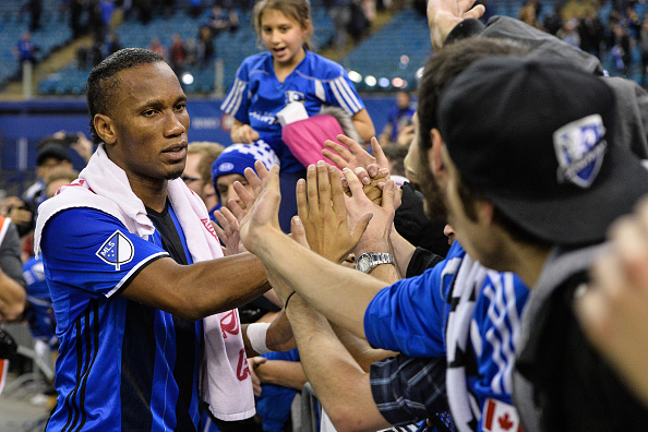 MONTREAL, QC - NOVEMBER 22:  Didier Drogba #11 of the Montreal Impact celebrates with fans during leg one of the MLS Eastern Conference finals against the Toronto FC at Olympic Stadium on November 22, 2016 in Montreal, Quebec, Canada.  The Montreal Impact defeated the Toronto FC 3-2.  (Photo by Minas Panagiotakis/Getty Images)